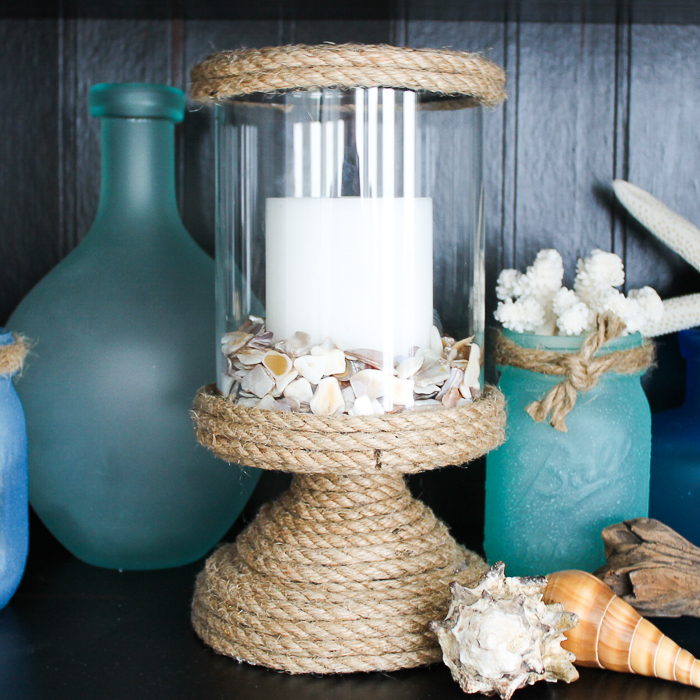 Turn a plain candle holder into diy beach decor using a bit of rope and some glue