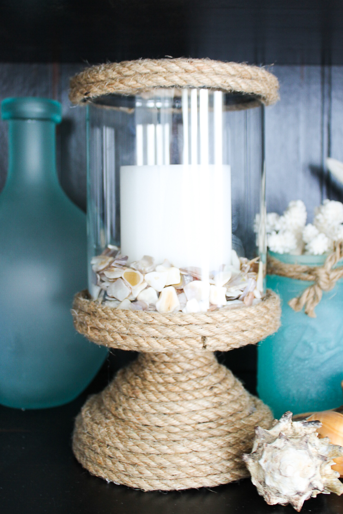 Rope wrapping a plain candle holder to make diy beach crafts