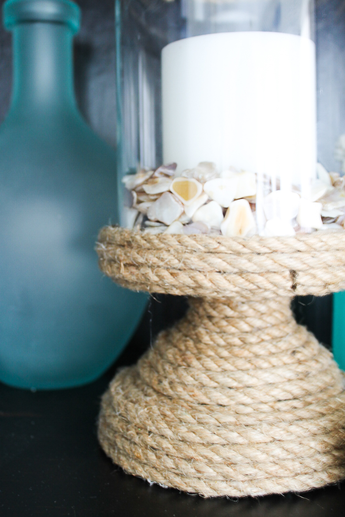 Make your own DIY beach bathroom decor with some rope and a bit of hot glue.