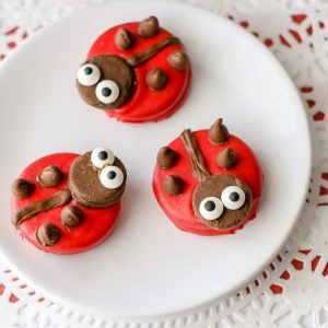 Ladybug decorated cookies on a white plate