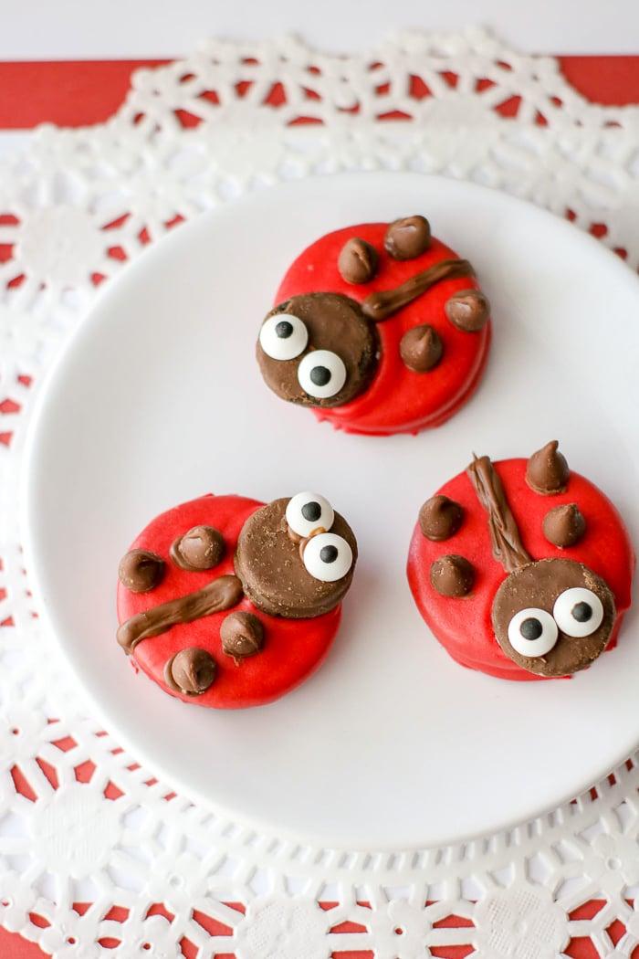 Oreo cookies made to look like ladybugs on a plate