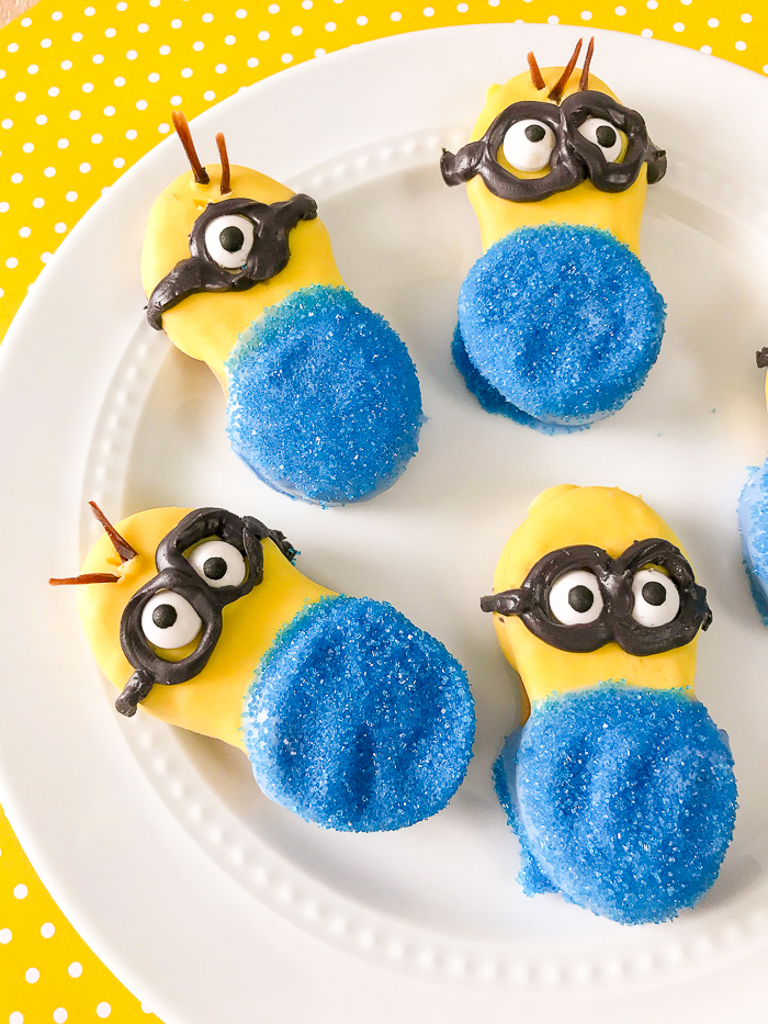 Cute minion cookies decorated on a white plate