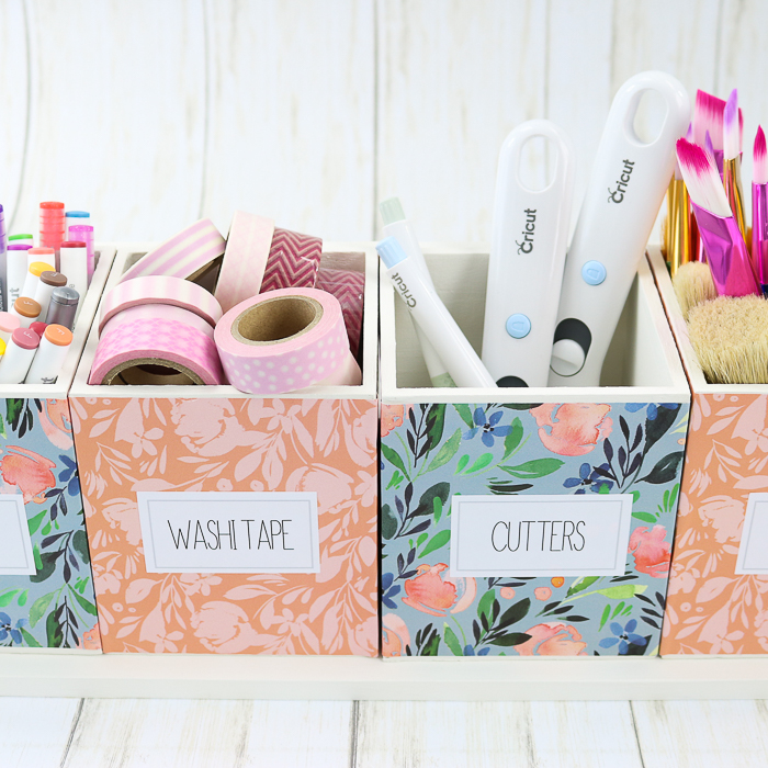 Adding craft supplies to an organizer with printable labels.
