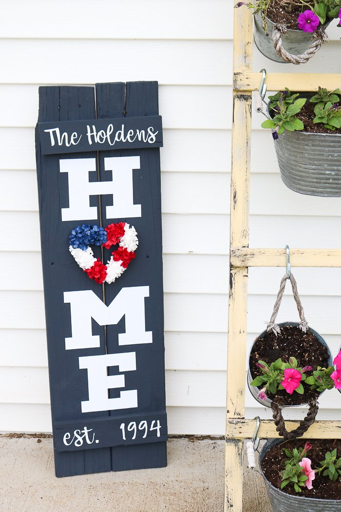 I used a patriotic red, white, and blue wreath as the O on my DIY home sign for the summer
