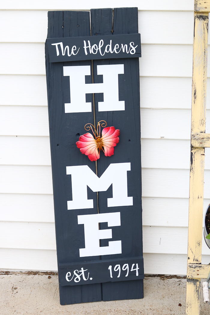 My DIY wood home sign with a metal butterfly garden ornament instead of a wreath for the O