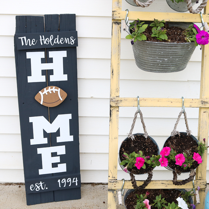 Football loving families can decorate their Home sign with a football as the O for football season