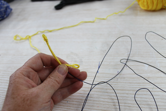 wrapping a wire word with yarn