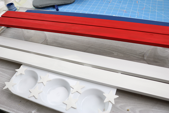 Paint the wooden slats red, white, and blue. Then attach the white stars