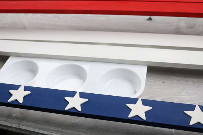 Add the white stars to the blue slat of your patriotic wood star