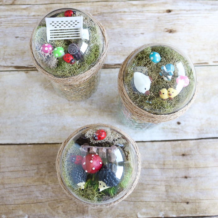 a miniature fairy garden on top of a mason jar
