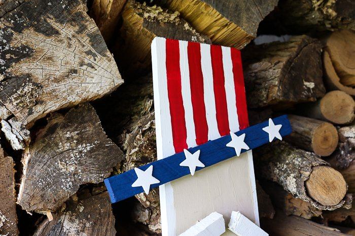 americana hat on a wooden uncle sam