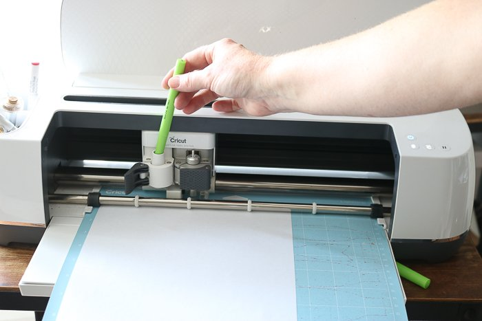 inserting pen into Cricut machine