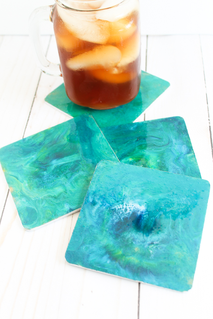 applying marbled resin to coasters