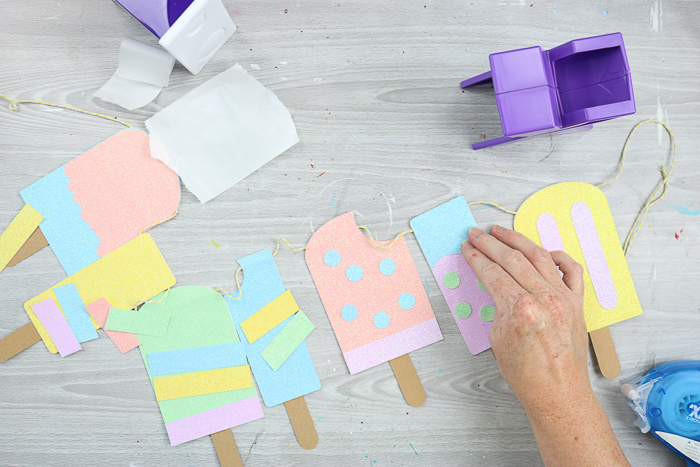 adding decorations to paper popsicles