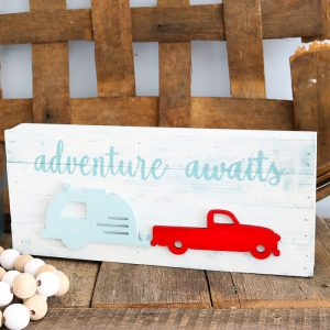 cute travel sign with a camper