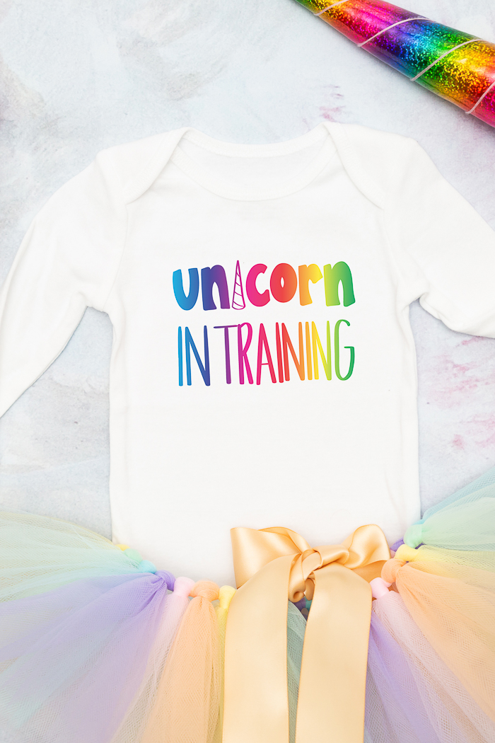 This unicorn in training onesie is just one amazing craft you can make with a free Unicorn SVG file