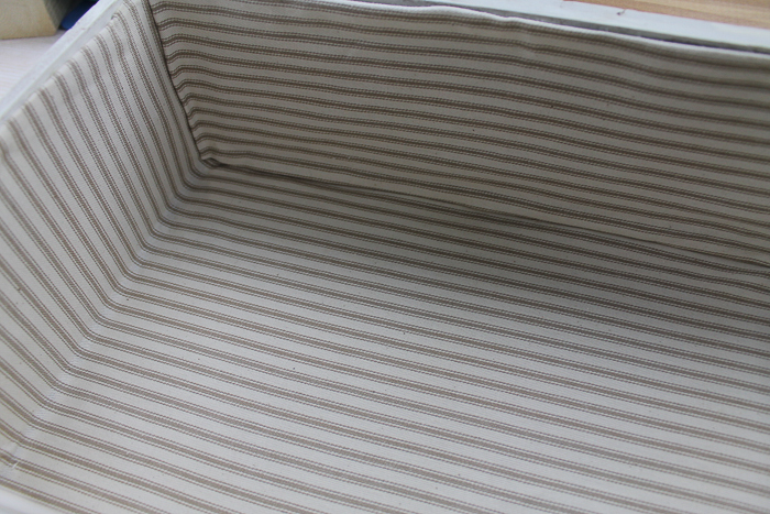adding striped fabric inside a card box for a wedding