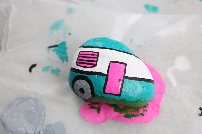Added painted wheels and accents to this camper painted rock