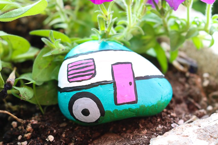 I love this camper painted rock, it fits in perfectly in my garden!