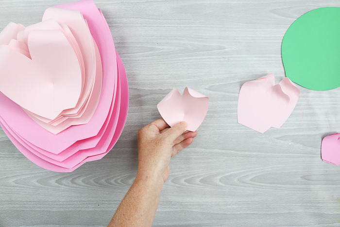 Now that you've created your flower petals using colorful construction paper, it's time to create the flowers
