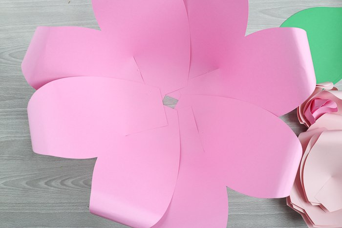 Use the largest paper flower petals to create the outside layer of the flower