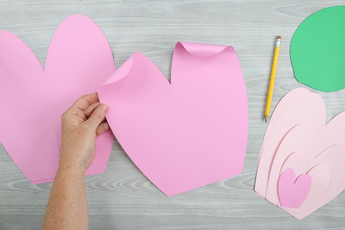 Curling the ends of your giant paper flowers makes them look much more like flower petals!