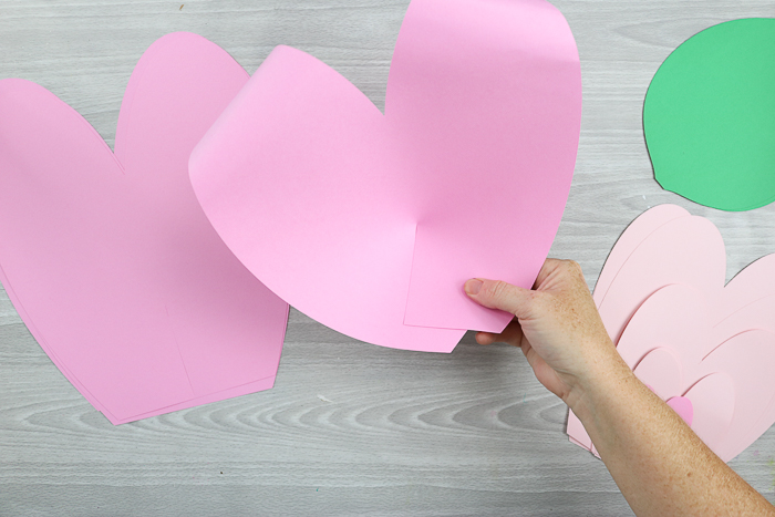 Glue the ends of your paper flower petals together to make a 2D petal shape