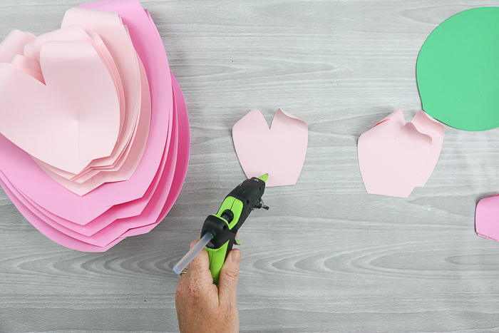 Create your paper flower petals using a hot glue gun