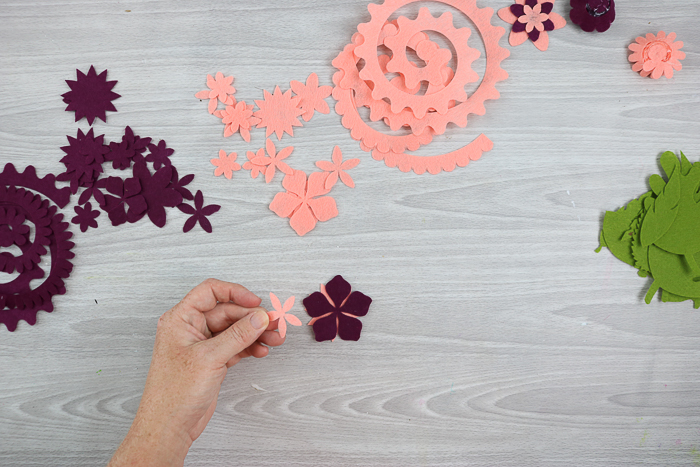 using hot glue to assemble Cricut flowers