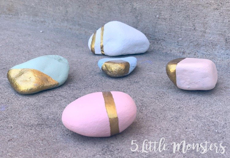geometric gold and pastel painted rocks