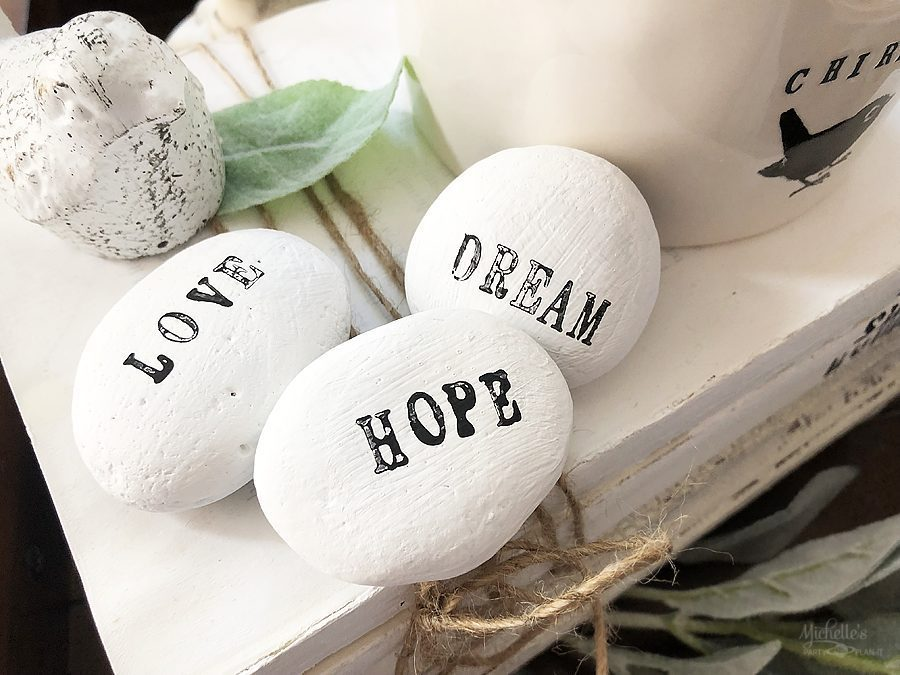 stamped painted rocks that say love, hope, and dream