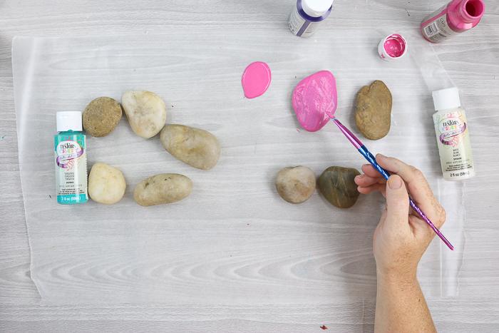 adding paint to rocks