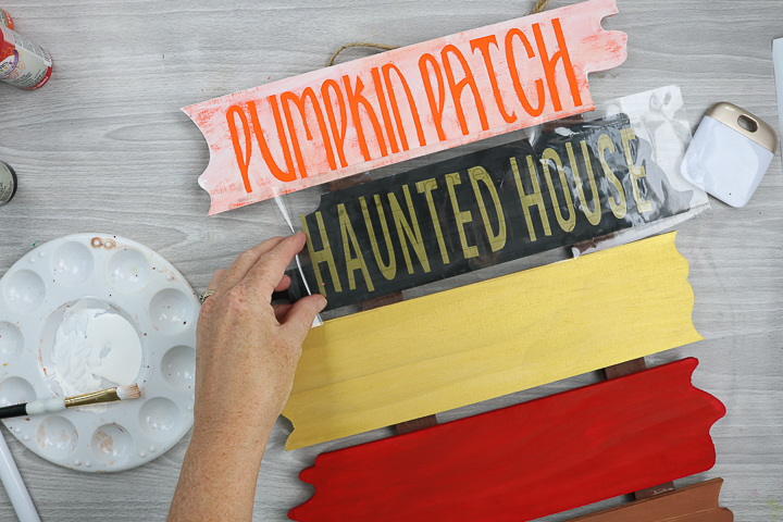adding cricut vinyl to halloween wood sign