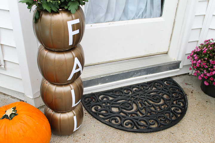 DIY fall planter with plastic pumpkins