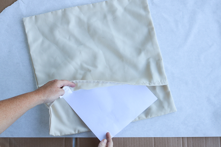 adding paper to inside of pillow cover