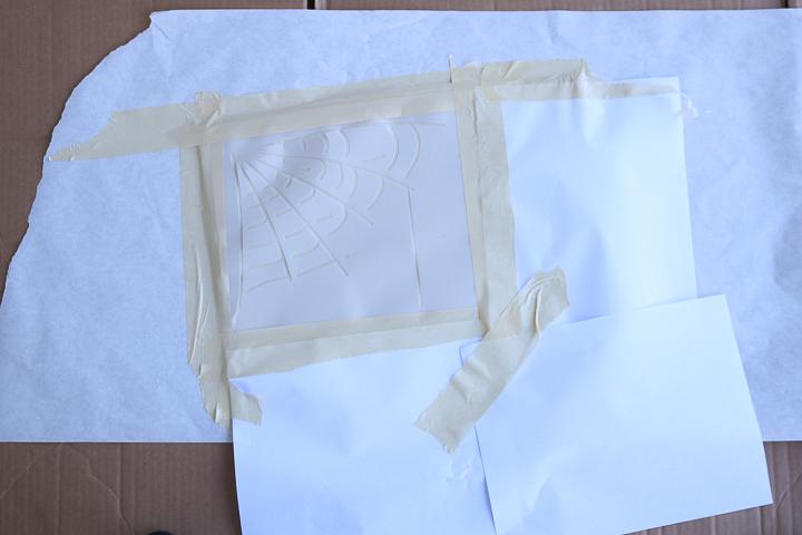 masking tape around stencil cut on cricut