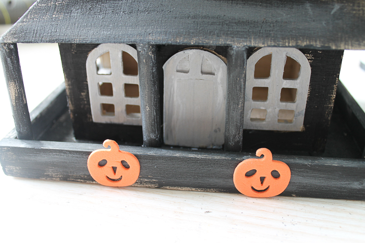 adding foam stickers to haunted house