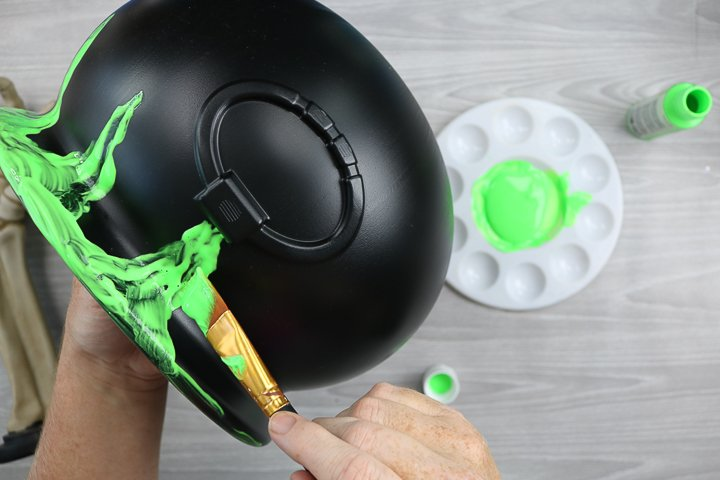adding glow in the dark paint to a halloween candy bucket