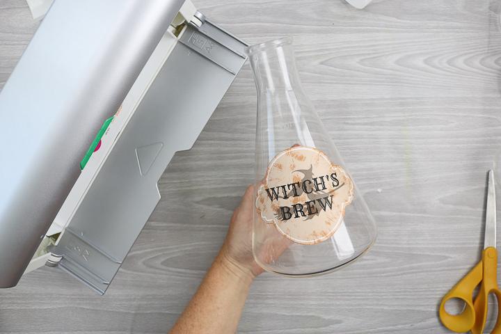 adding xyron stickers to glass jars