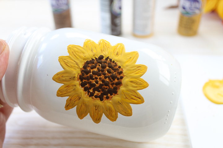 learning how to paint a sunflower on a jar