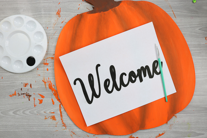 adding welcome lettering to pumpkin shape