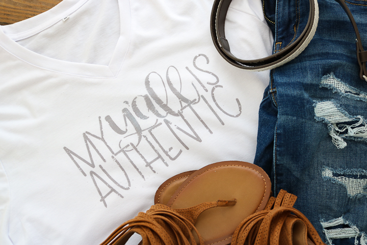 A stylish distressed shirt made with Cricut infusible ink.