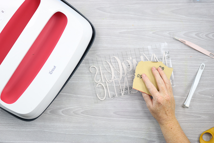 Use sandpaper to distress the infusible ink sheet.