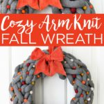 Make this DIY fall wreath with chunky yarn! Arm knit a wreath then add on decor for a unique twist on autumn door decor that you will love! #fall #wreath #autumn #yarn #knitting #armknit #armknitting #pompoms #bow #fallwreath #door #doordecor #doorhanger #crafts #diy