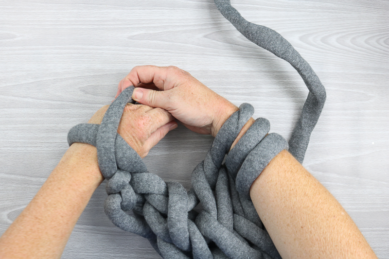 completing an arm knit craft idea