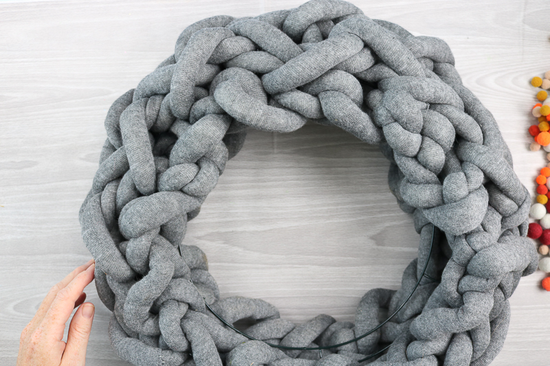 adding wreath form to arm knitting craft