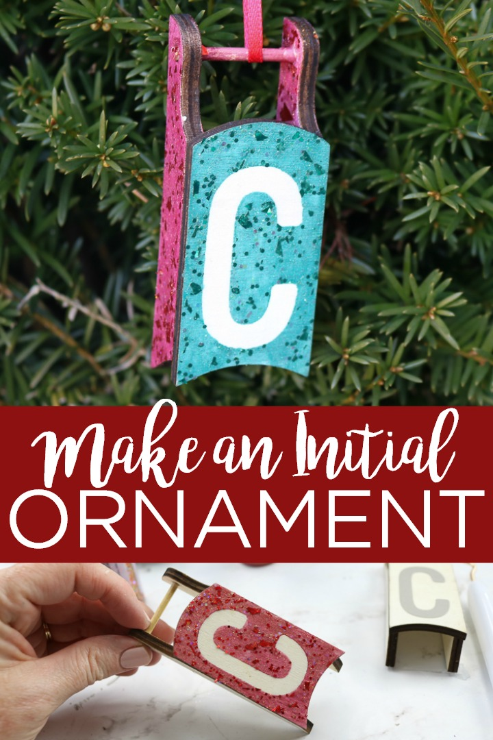 You can make an initial ornament with a small wood sled and some glitter paint! This fun project is perfect for kids and your Christmas tree! #christmas #christmasornament #christmastree #sled #glitter #glittercraft #craft #diy #wood #woodsled #holidays