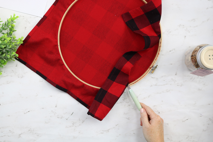 christmas plaid fabric in an embroidery hoop