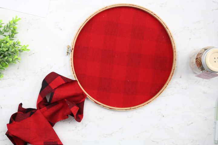 trimming excess fabric from an embroidery hoop