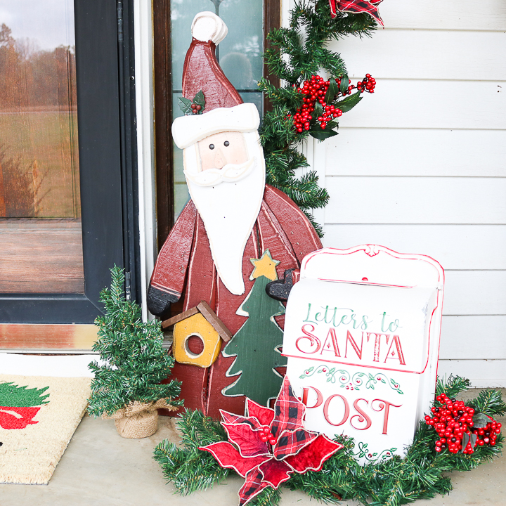 wood santa on front porch